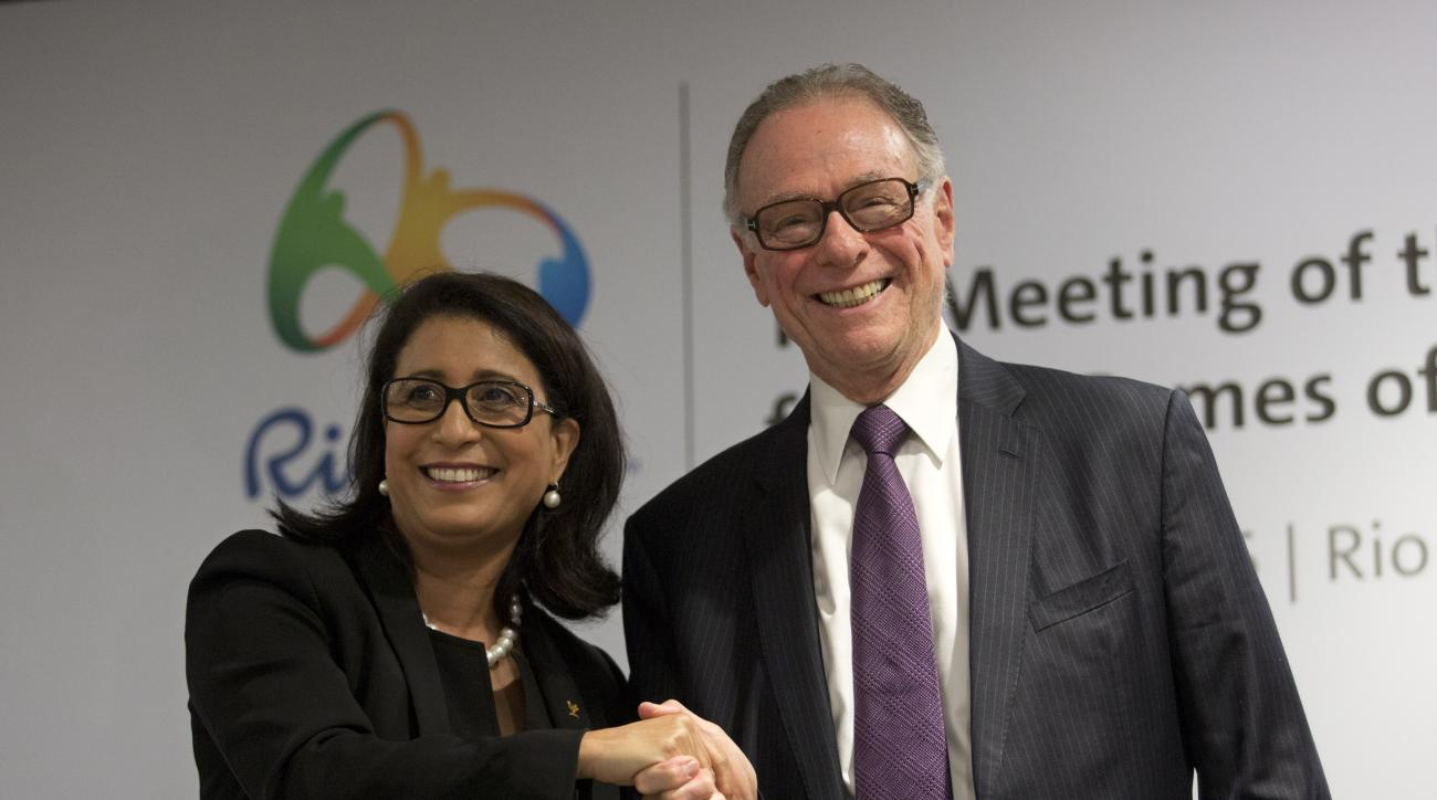 Nawal El Moutawakel, head of the International Olympic Committee's evaluation commission, left, and Brazil Olympic Committee President Carlos Arthur Nuzman pose for a photo after a press conference in Rio de Janeiro, Brazil, Wednesday, April 13, 2016.  Ri
