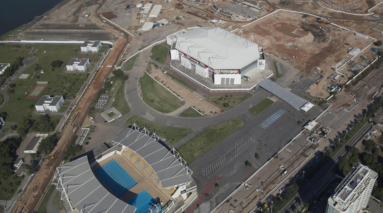 FILE - This June 27, 2014 file photo, shows the Olympic Arena, top, and the Maria Lenk Aquatics Center under construction in Rio de Janeiro, Brazil. Two winners will get to stay overnight next week, in April 2016, in a converted VIP box set up in the Olym