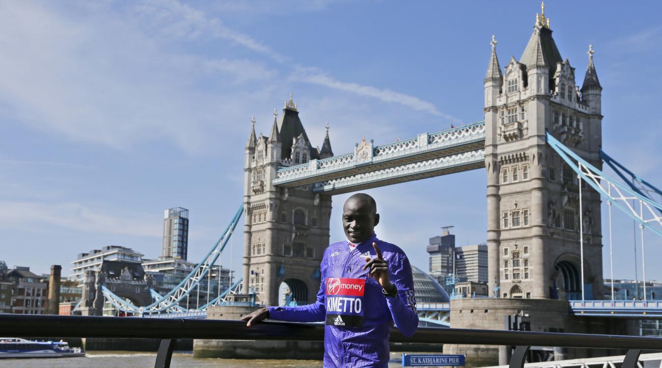 Kenya's Dennis Kimetto poses for photographers ahead of the London marathon, near Tower Bridge in London, Wednesday, April 20, 2016. The London marathon will take place on Sunday. (AP Photo/Frank Augstein)