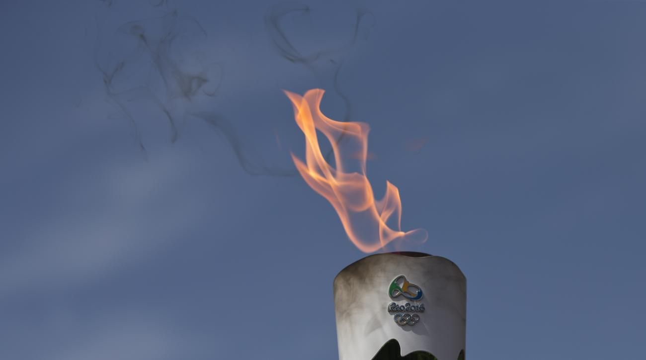 A lit torch of the Rio de Janeiro Olympic games during a dress rehearsal for the lighting of the Rio Olympics flame, in Ancient Olympia, southern Greece,  on Wednesday, April 20, 2016. The meticulously choreographed ceremony will be repeated Thursday in t