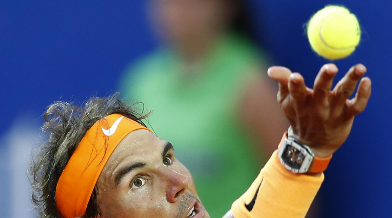 Spain's Rafael Nadal returns a ball to Japans Kei Nishikori during the Barcelona Open tennis tournament final in Barcelona, Spain, Sunday, April 24, 2016. Spain's Rafael Nadal defeated Japans Kei Nishikori 6-4 and 7-5, in the final. (AP Photo/Manu Fernand