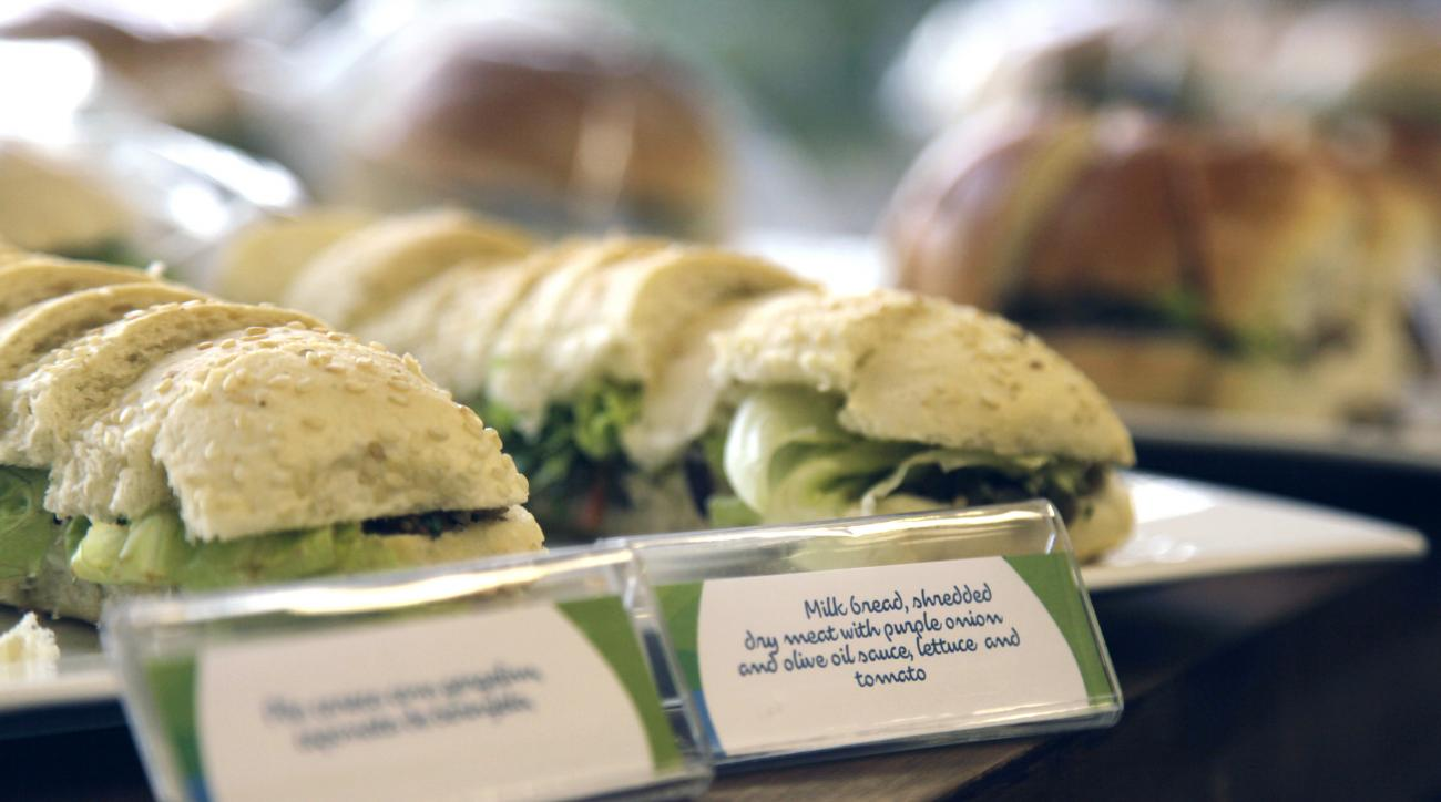 This May 6, 2016 photo shows meat sandwiches during one of many food-testing exercises of the Olympic menu in Rio de Janeiro, Brazil. Diners will choose from five different buffets: Brazilian, Asian, International, Pasta and Pizza, Halal and Kosher, and e