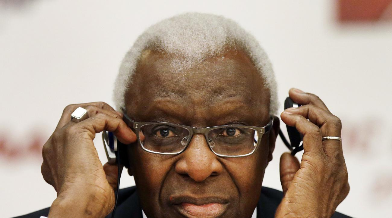 FILE - In this Aug. 21, 2015, file photo, then-IAAF president Lamine Diack adjusts his headphones during a joint IOC and IAAF news conference on the site of the World Athletic Championships in Beijing. French prosecutors say $2 million associated with Tok
