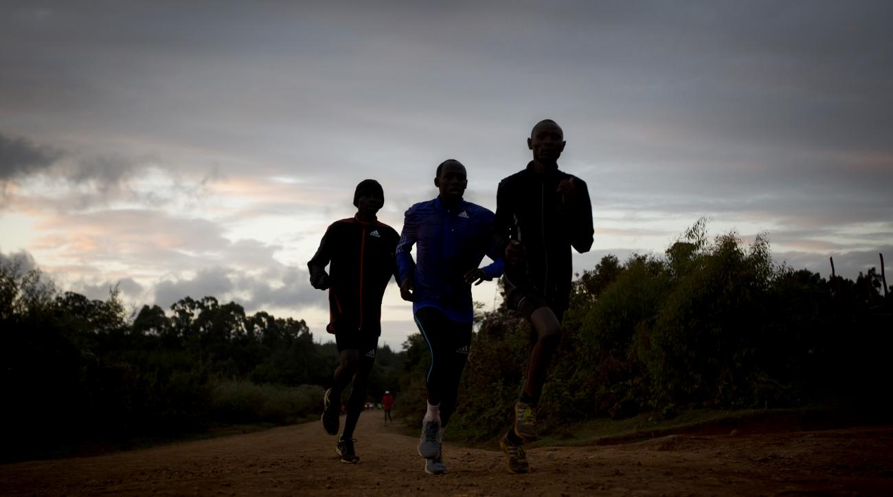 FILE - In this Saturday, Jan. 30, 2016 file photo, Kenyan athletes train just after dawn, in Kaptagat Forest in western Kenya. World Anti-Doping Agency (WADA) officials declared Kenya's drug-fighting agency out of compliance Thursday, May 12, 2016, a move
