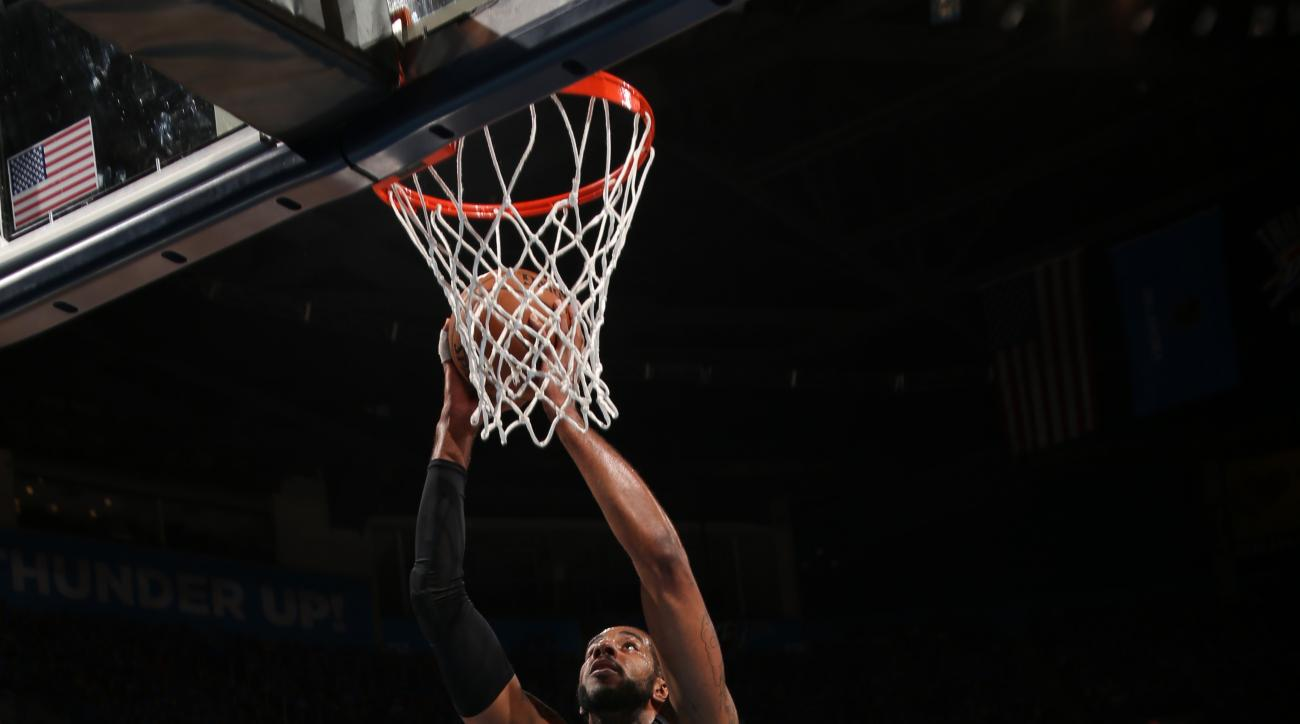 OKLAHOMA CITY, OK - MAY 12: LaMarcus Aldridge #12 of the San Antonio Spurs shoots the ball against the Oklahoma City Thunder in Game Six of Western Conference Quarterfinals of the 2016 NBA Playoffs on May 12, 2016 Chesapeake Energy Arena in Oklahoma City,
