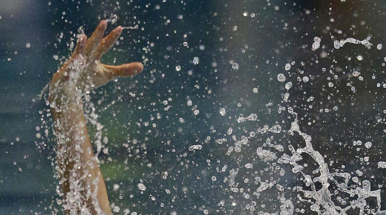 Ryan Lochte swims during the 100m Backstroke event in the Arena Pro Swim Series in Charlotte, N.C., Saturday, May 14, 2016. (AP Photo/Chuck Burton)