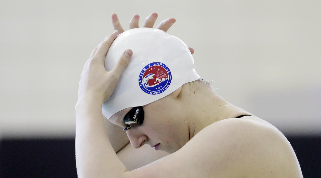Katie Ledecky adjusts her swim cap before the start of the 400-meter freestyle at the Atlanta Classic swim meet Saturday, May 14, 2016, in Atlanta. (AP Photo/David Goldman)