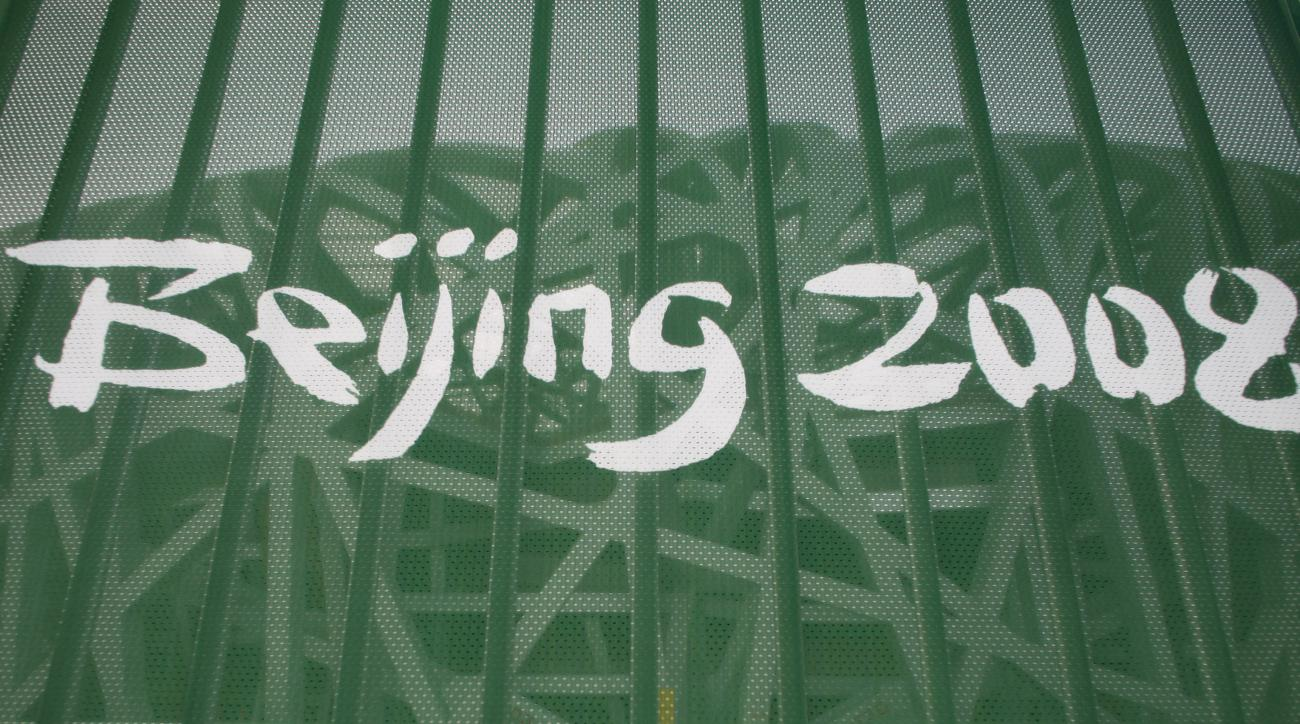 "FILE - In this Aug. 7, 2008 file photo a protective fence shows a Beijing 2008 logo outside the National Stadium, known as the ""Birds Nest"", in Beijing. The IOC said Wednesday, May 17, 2016 31 athletes in six sports have tested positive in reanalysis of t"
