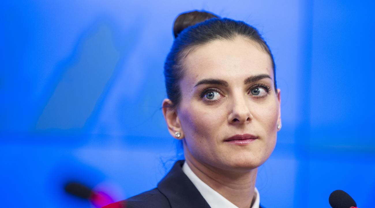 FILE - In this Thursday, Feb. 12, 2015 file photo, Russia's pole vaulter Yelena Isinbayeva attends a press conference in Moscow, Russia. Two-time Olympic pole vault champion Yelena Isinbayeva says on Monday, May 23, 2016 she will file suit if Russias ban