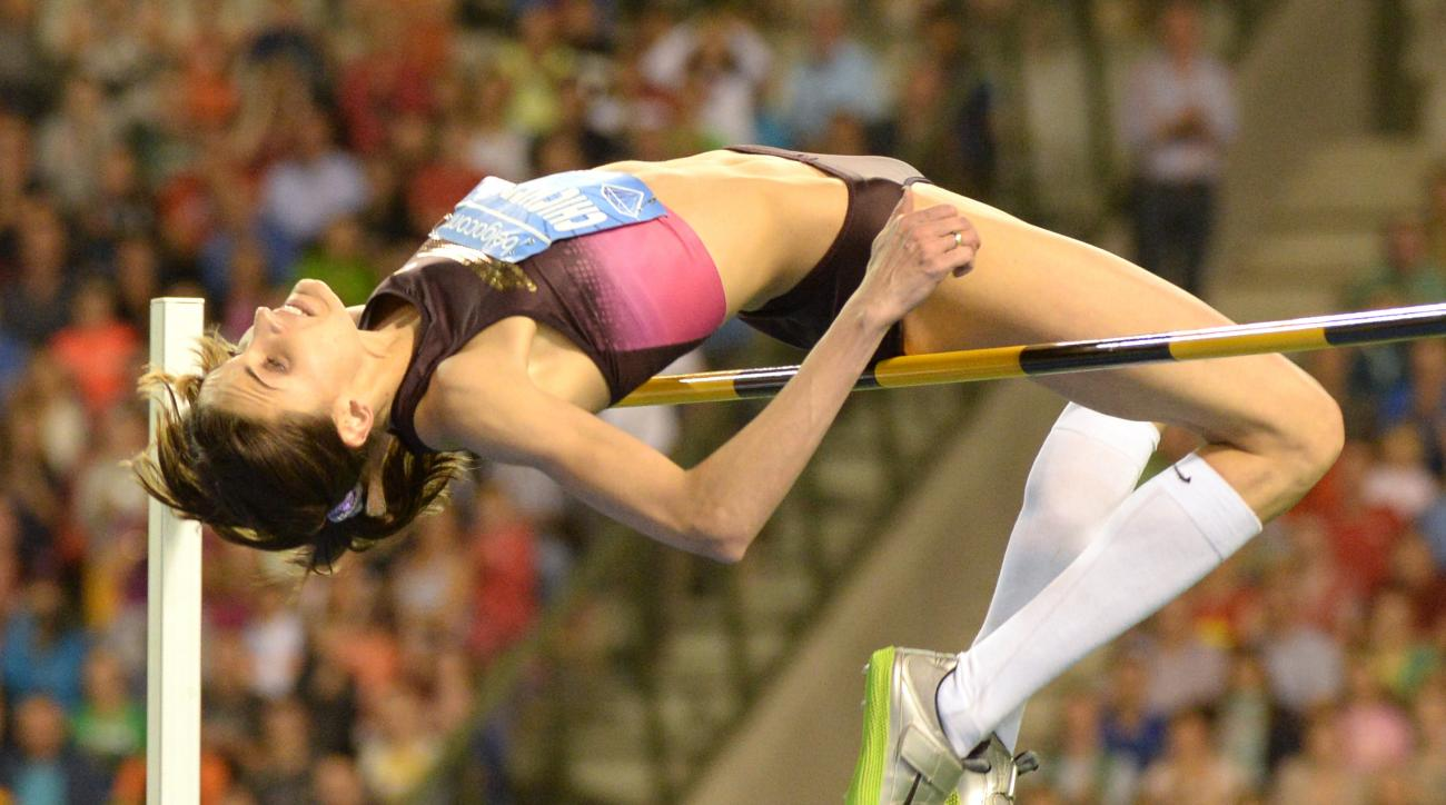FILE -  In this Friday, Sept. 6, 2013 file photo Anna Chicherova from Russia competes at the women's high jump at Brussels' King Baudouin stadium, Belgium. The coach of 2012 Olympic high jump champion Anna Chicherova, Yevgeny Zagorulko, told Russian state