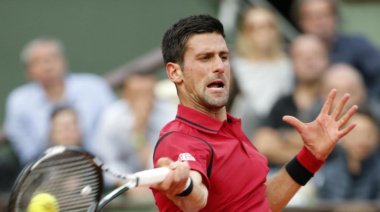 Serbia's Novak Djokovic returns in the third round match of the French Open tennis tournament against Britains Aljaz Bedene at the Roland Garros stadium in Paris, France, Saturday, May 28, 2016. (AP Photo/Alastair Grant)