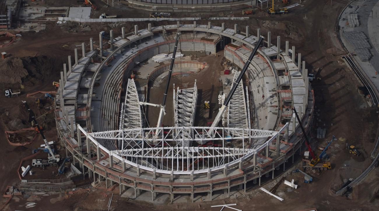 FILE - In this July 27, 2015 file photo, a construction crews work on the velodrome at the Olympic Park for Rio's 2016 Olympics, in Rio de Janeiro, Brazil. The venue that faces the most serious building delay hit another snag Monday, May 30, 2016, when th