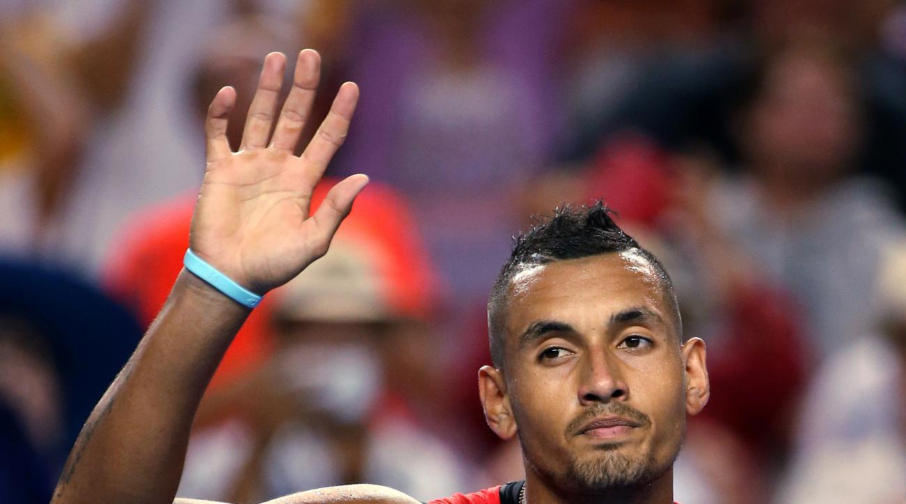 FILE - In this Jan. 18, 2016, file photo, Nick Kyrgios of Australia waves after defeating Carreno Busta of Spain during their first round match at the Australian Open tennis championships in Melbourne, Australia. Kyrgios has withdrawn his name from consid