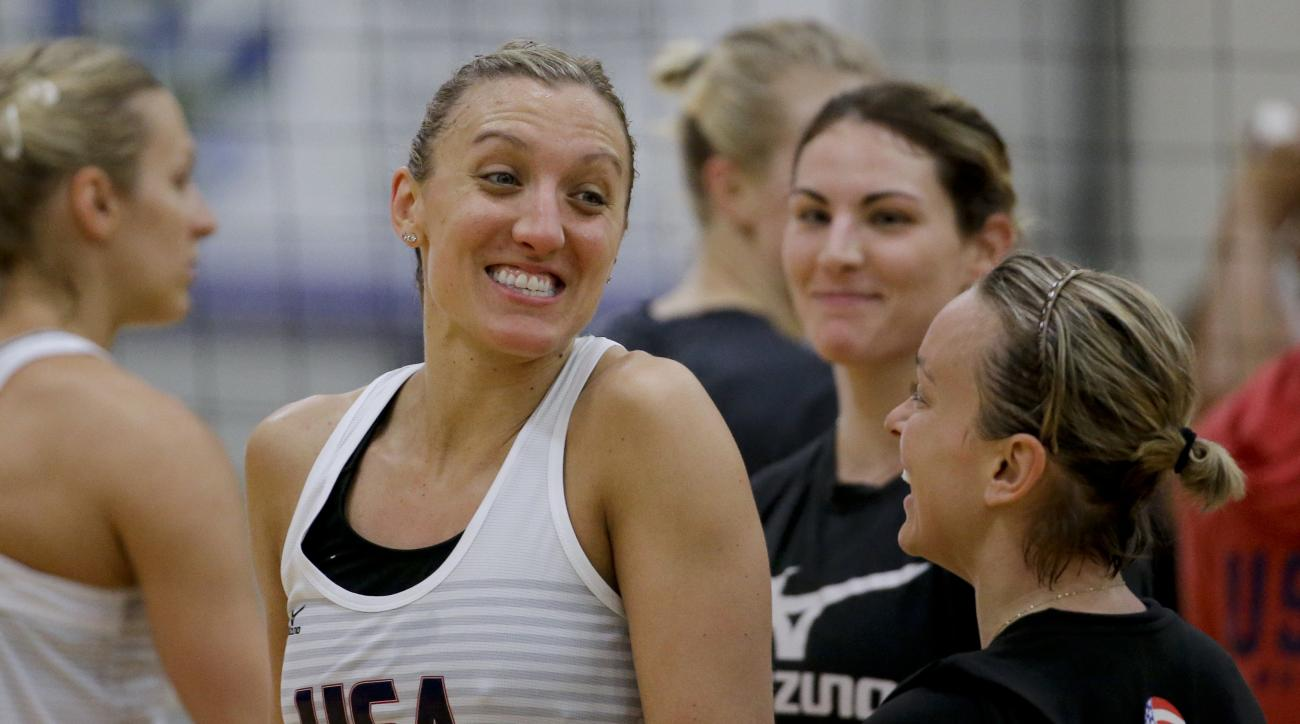 In this Tuesday, May 24, 2016, photo, Jordan larson, left, Kayla Banwarth, right, celebrate a point as Kelly Murphy looks during the U.S. women's national volleyball team practice in Anaheim, Calif. When the U.S. women's volleyball team got together month