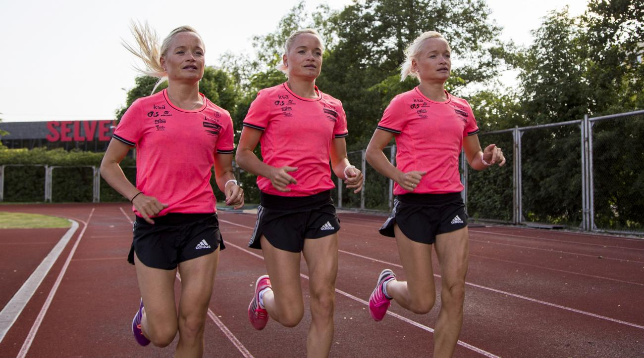 In this photo taken on Thursday, June 2, 2016, Estonian athletes sisters Lily Luik, left, Liina Luik, center, and Leila Luik attend a training session after an interview with The Associated Press at a track in Estonia. The 30-year-old sisters will be the