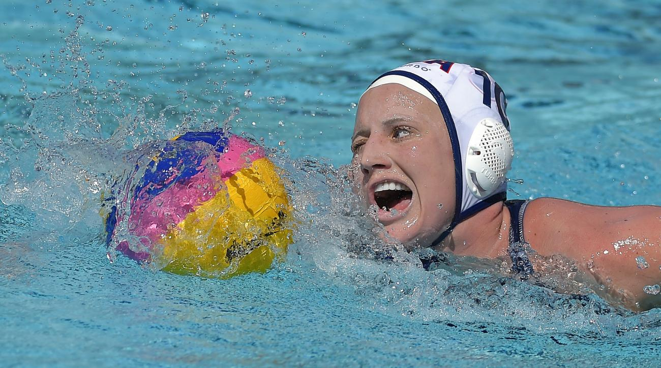 FILE - In this May 22, 2016, file photo, United States attacker Kaleigh Gilchrist moves the ball during a women's exhibition water polo match against Australia,  in Los Angeles. Kaleigh Gilchrist could be traveling the world right now with her surfboard,