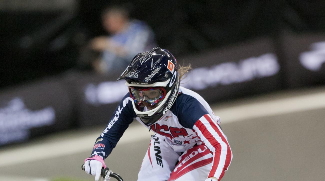 FILE - In this  April 19, 2013, file photo, Alise Post, of the United States, rides to second place in the women's elite competition at the BMX Supercross World Championships, in Manchester, England. After getting left off the podium at worlds in 2015, th