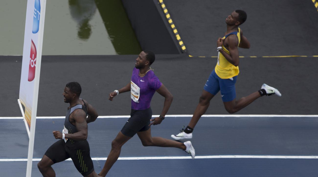 "U.S. athlete Justin Gatlin, left, finishes ahead of Trinidad and Tobago's Richard Thompson, center, and the Brazil's Vitor Hugo Santos, during the ""Mano a Mano"" challenge at the Quinta da Boavista in Rio de Janeiro, Brazil, Sunday, June 5, 2016. Gatlin wo"