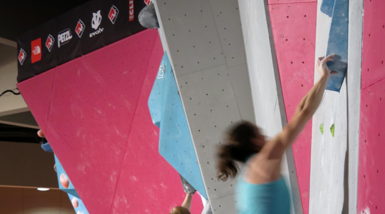 In this Jan. 29, 2016 photo, contestants compete in the Bouldering Open National Championships at Monona Terrace in Madison, Wis. Bouldering is a discipline in the sport of climbing. Climbing is on the precipice of becoming an Olympic sport, raising the p