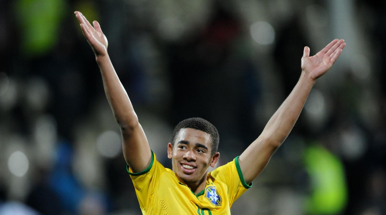 FILE - In this June 17, 2015 file photo, Brazil's Gabriel Jesus celebrates following a U20 soccer World Cup semifinal game against Senegal in Christchurch, New Zealand. Brazil football fans are more excited with their young Olympic team than with the squa