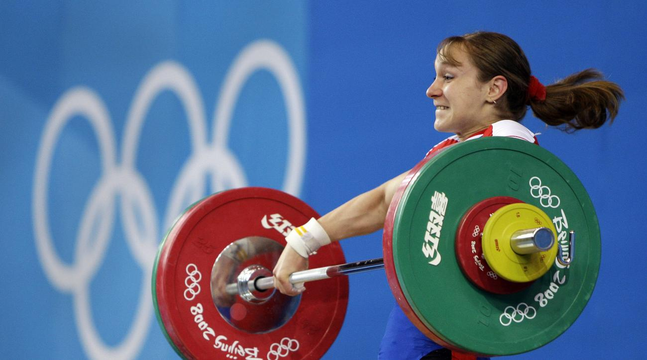 """FILE In this Monday, Aug. 11, 2008 file photo Marina Shainova of Russia lifts 98 kilograms in the snatch of the women's 58 kg category of the weightlifting competition at the Beijing 2008 Olympics in Beijing. Russian state news agency Tass says the """"B'' s"""