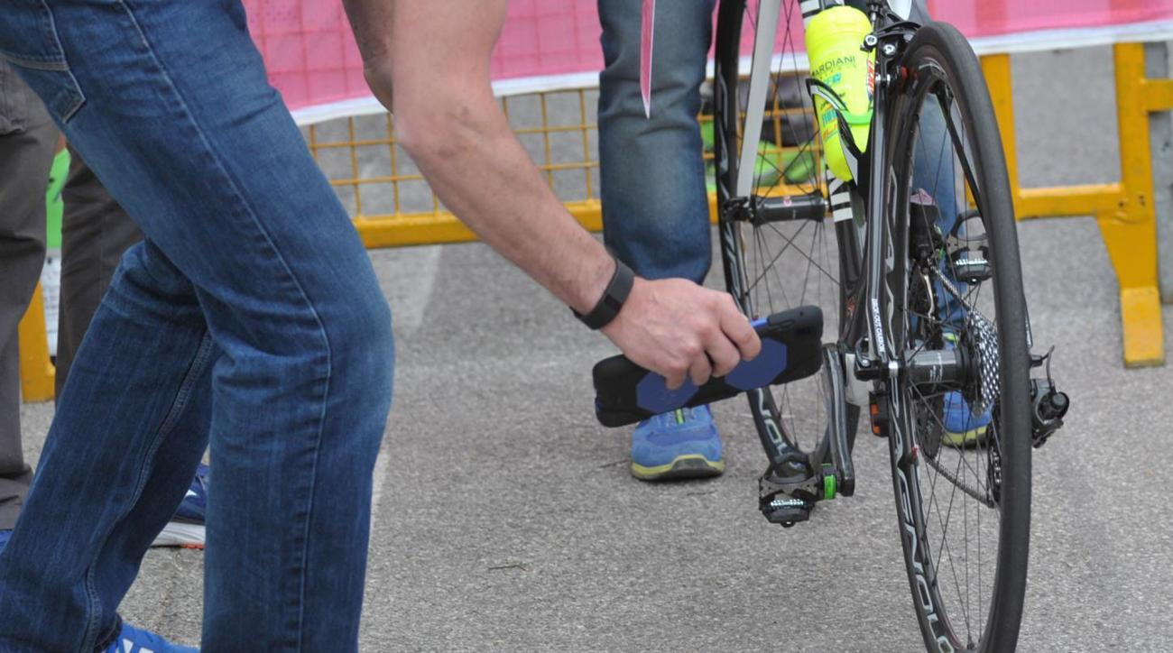 In this May 18, 2016 photo, a bicycle is inspected after arriving in Asolo, Italy after the 11th stage of the Giro d'Italia cycling race. There is perhaps no Olympic sport as dependent on technology as cycling, where space-age, feather-light carbon fiber
