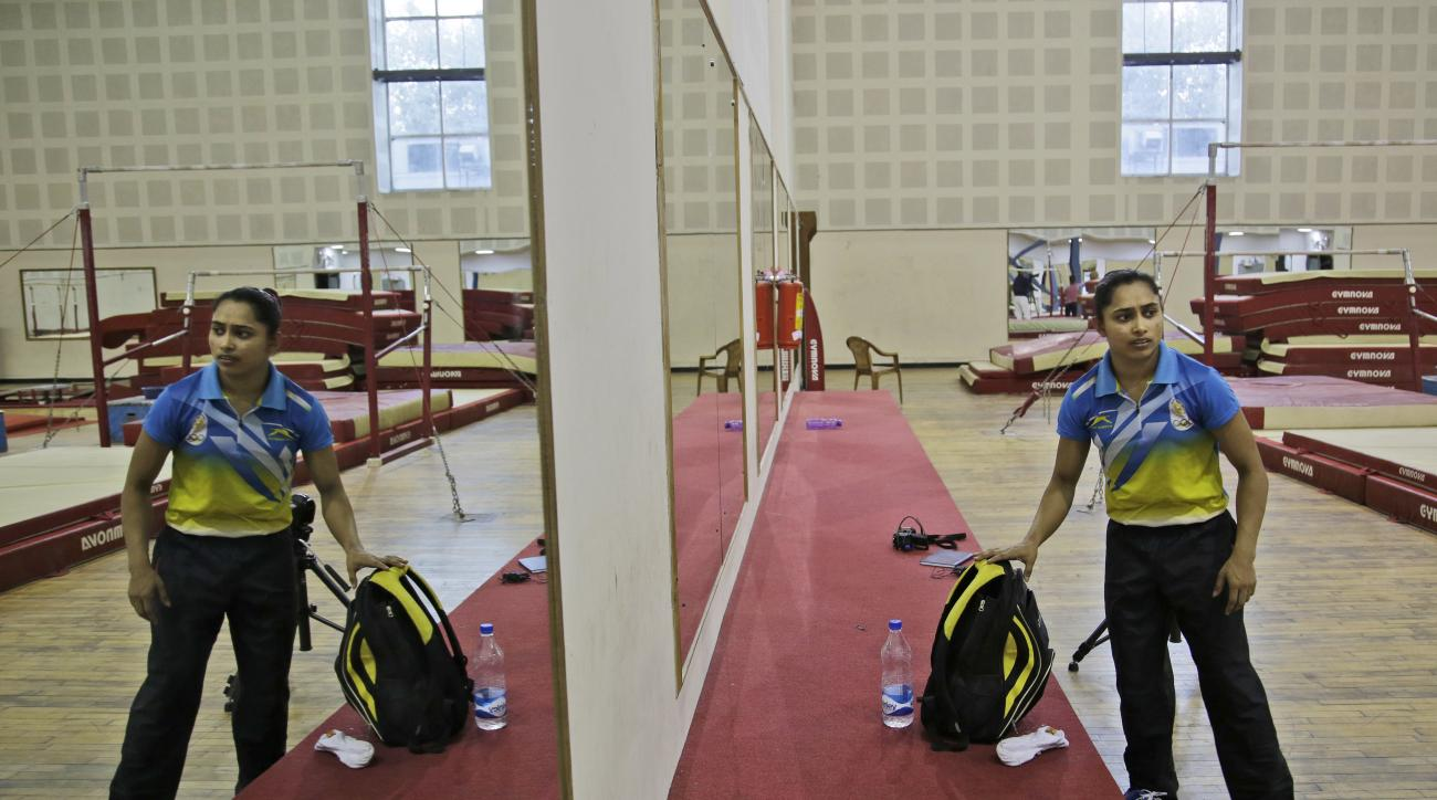 In this May 21, 2016, photo, Indian woman gymnast Dipa Karmakar arrives for an interview at the practice arena of Indira Gandhi Indoor Stadium in New Delhi, India. The first Indian woman gymnast to qualify for the Olympics once again banks on the difficul