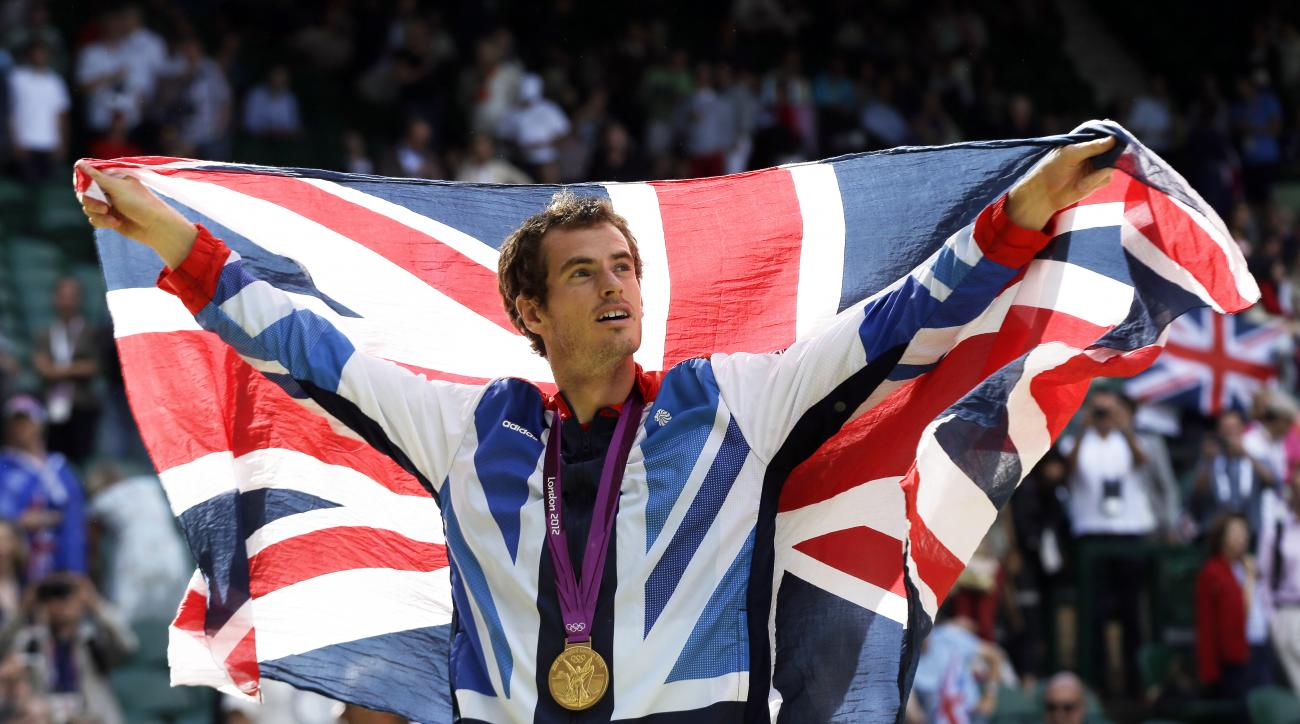FILE - In this Sunday, Aug. 5, 2012 file photo, gold medalist Andy Murray of Great Britain waves the British flag during the medal ceremony of the men's singles event at the All England Lawn Tennis Club at Wimbledon, in London, at the 2012 Summer Olympics