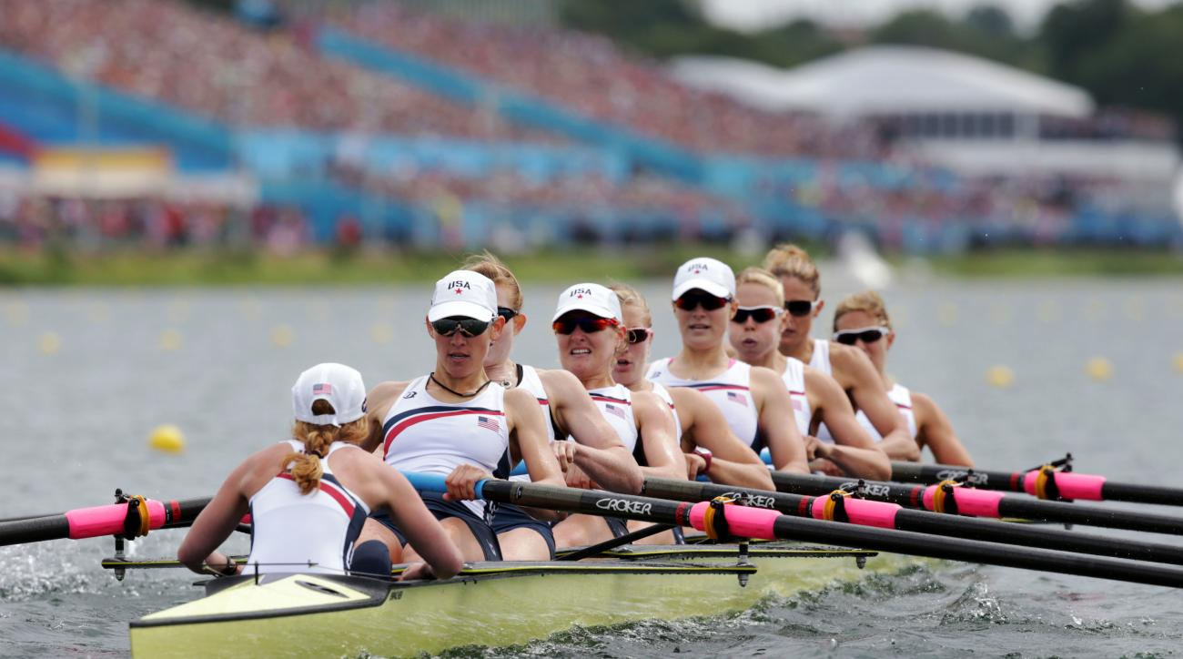 FILE - In this Aug. 2, 2012, file photo, U.S. rowers Mary Whipple, Caryn Davies, Caroline Lind, Eleanor Logan, Meghan Musnicki, Taylor Ritzel, Esther Lofgren, Zsuzsanna Francia and Erin Cafaro row on their way to winning the gold medal for the women's row