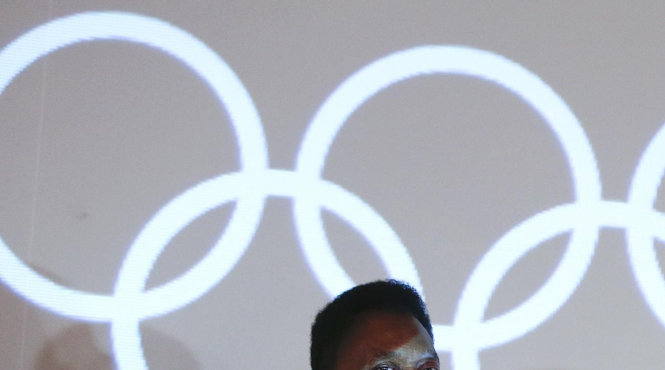 Brazilian soccer great Pele attends a ceremony at which he'll be honored with the Olympic Order at the Pele Museum in Santos, Brazil, Thursday, June 16, 2016. Rio de Janeiro will host the Olympic games starting on Aug. 5. (AP Photo/Andre Penner)