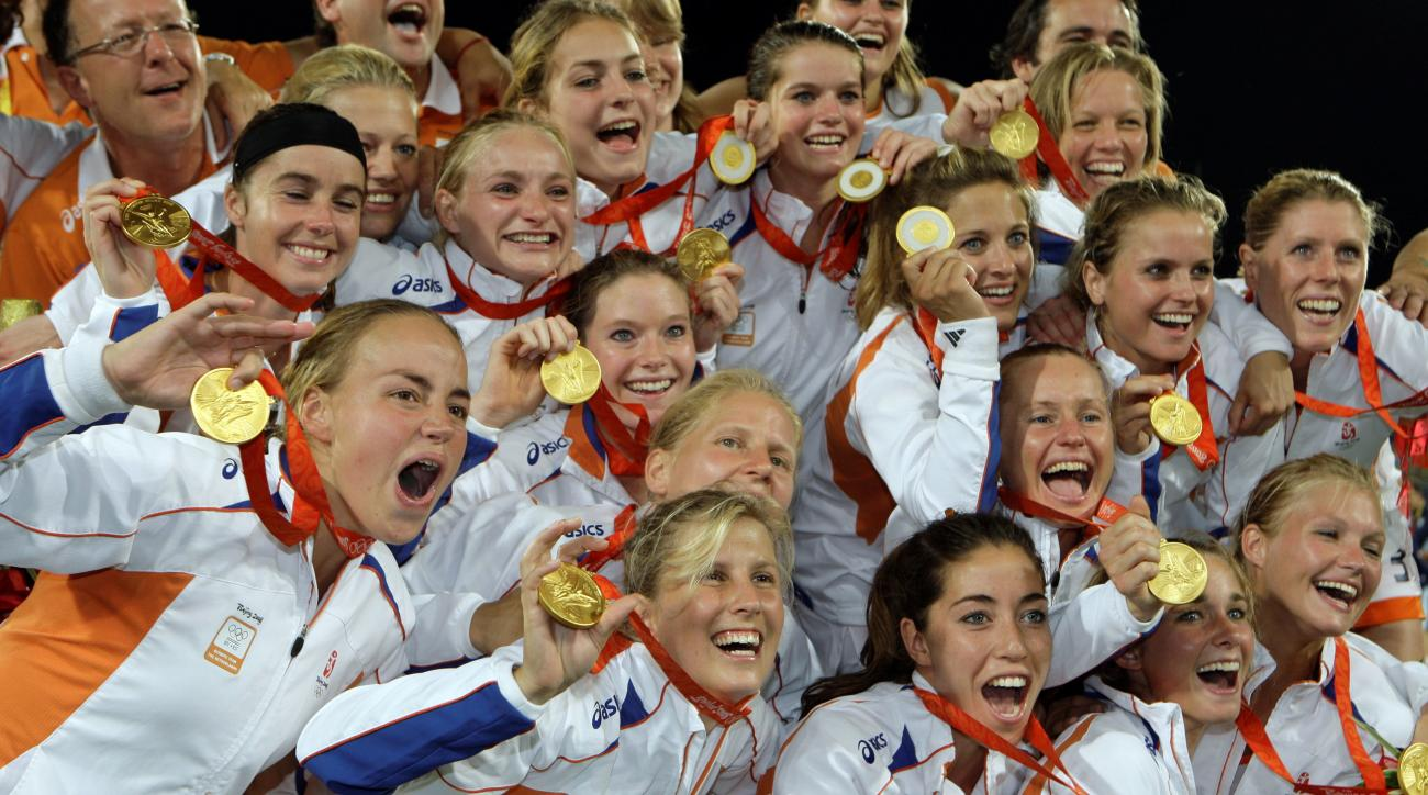 FILE - In this Aug. 22, 2008, file photo, Netherlands players celebrate with their gold medals after defeating China 2-0 in the women's gold medal field hockey match at the Olympic Hockey Center at the Beijing 2008 Olympics in Beijing. The Netherlands wil