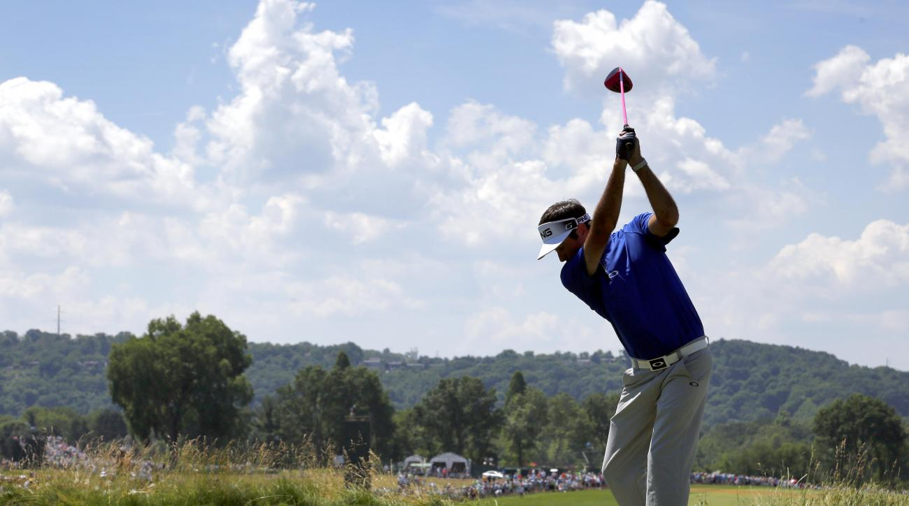Bubba Watson hits his tee shot on the fourth hole during the rain delayed second round of the U.S. Open golf championship at Oakmont Country Club on Saturday, June 18, 2016, in Oakmont, Pa. (AP Photo/Gene J. Puskar)