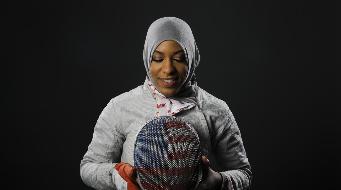 FILE - In this March 8, 2016, file photo, Fencer Ibtihaj Muhammad poses for photos at the 2016 Olympic Team USA media summit in Beverly Hills, Calif. Muhammad will make history at the Rio Games by becoming the first American athlete to wear a hijab _ a Mu
