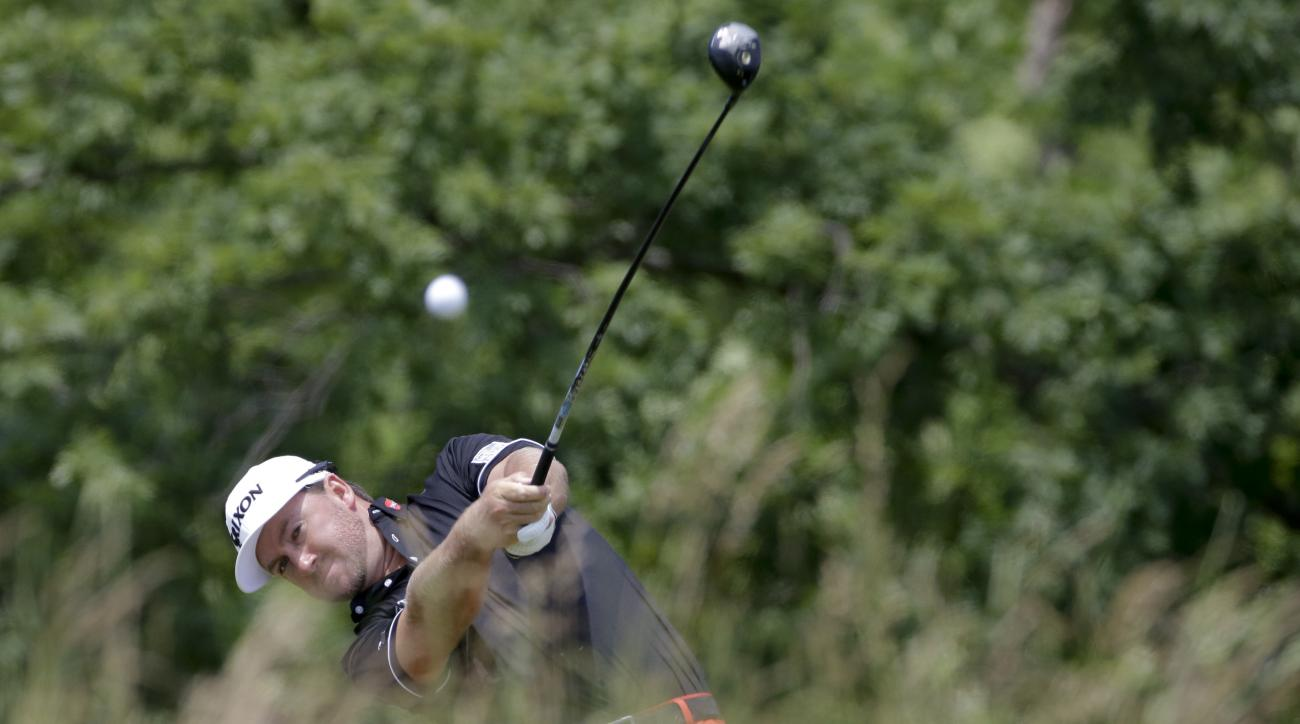 Graeme McDowell, of Northern Ireland, hits his tee shot on the fourth hole during the final round of the U.S. Open golf championship at Oakmont Country Club on Sunday, June 19, 2016, in Oakmont, Pa. (AP Photo/Gene J. Puskar)