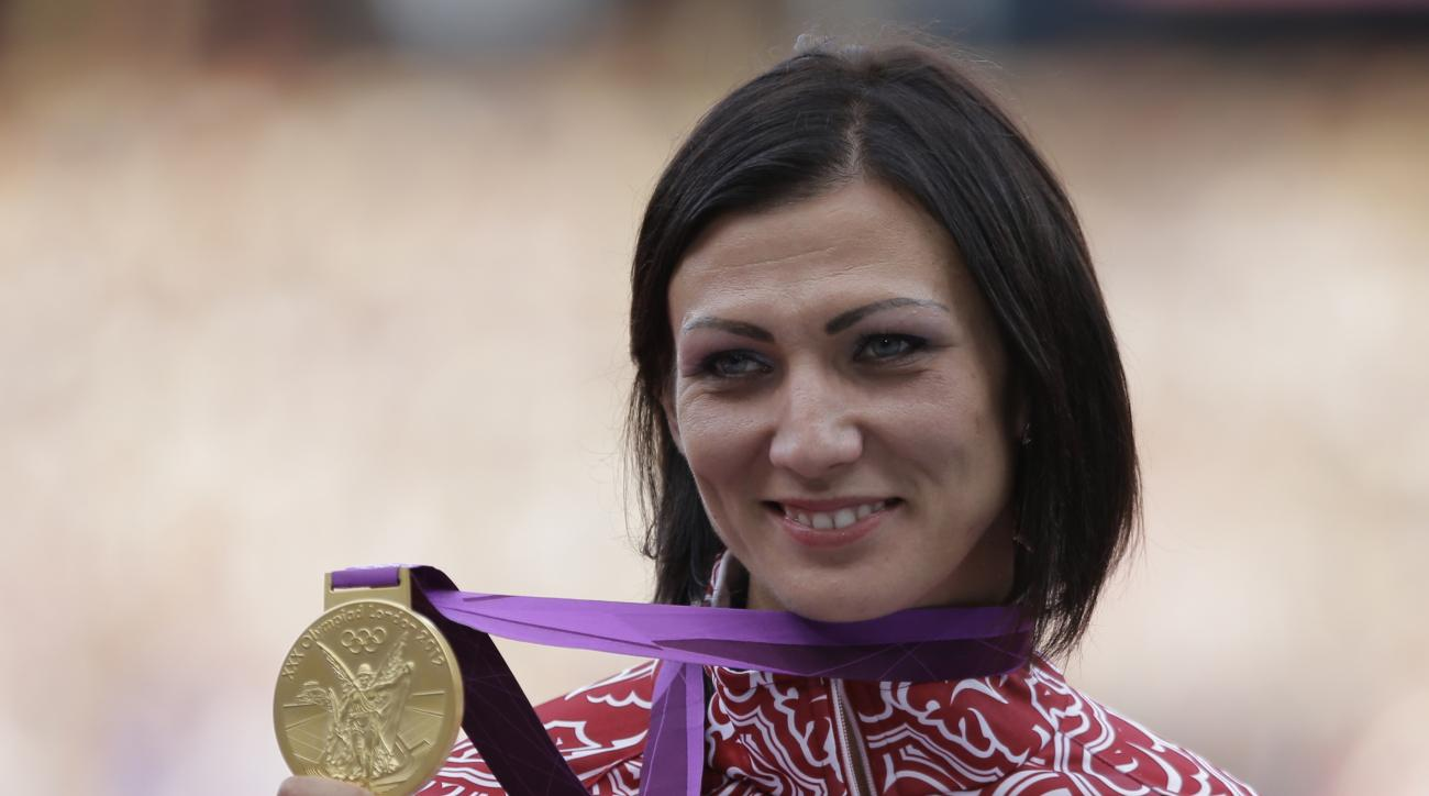 FILE - In this file photo taken on Thursday, Aug. 9, 2012, Russia's Natalya Antyukh displays the gold medal for women's 400-meter hurdles during a ceremony in the Olympic Stadium at the 2012 Summer Olympics, London. The Russian national track and field ch