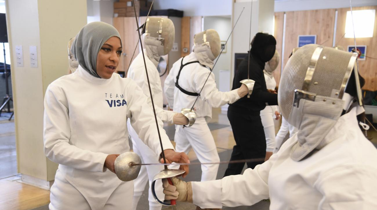 FILE - In this June 2, 2016, file photo, Team Visa athlete Ibtihaj Muhammad leads an interactive fencing demonstration in New York. This year more than ever, the so-called ``face'' of the Olympics could be a wrestler, or a fencer, or an athlete who most o