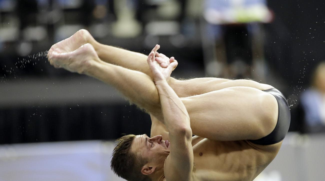 Troy Dumais dives during the men's 3-meter springboard semifinal at the U.S. Olympic diving trials Monday, June 20, 2016, in Indianapolis. (AP Photo/Darron Cummings)