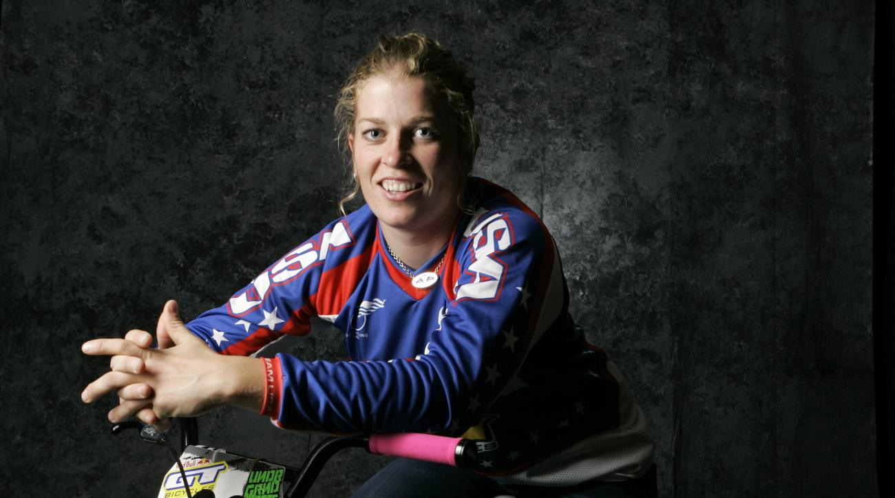 In this April 16, 2008 file photo, BMX cyclist Jill Kintner poses for a portrait during the USOC Media Summit in Chicago. Kintner is one of the worlds best downhill mountain bikers, hurtling herself down rock-strewn trails at breakneck speeds in an Adrena