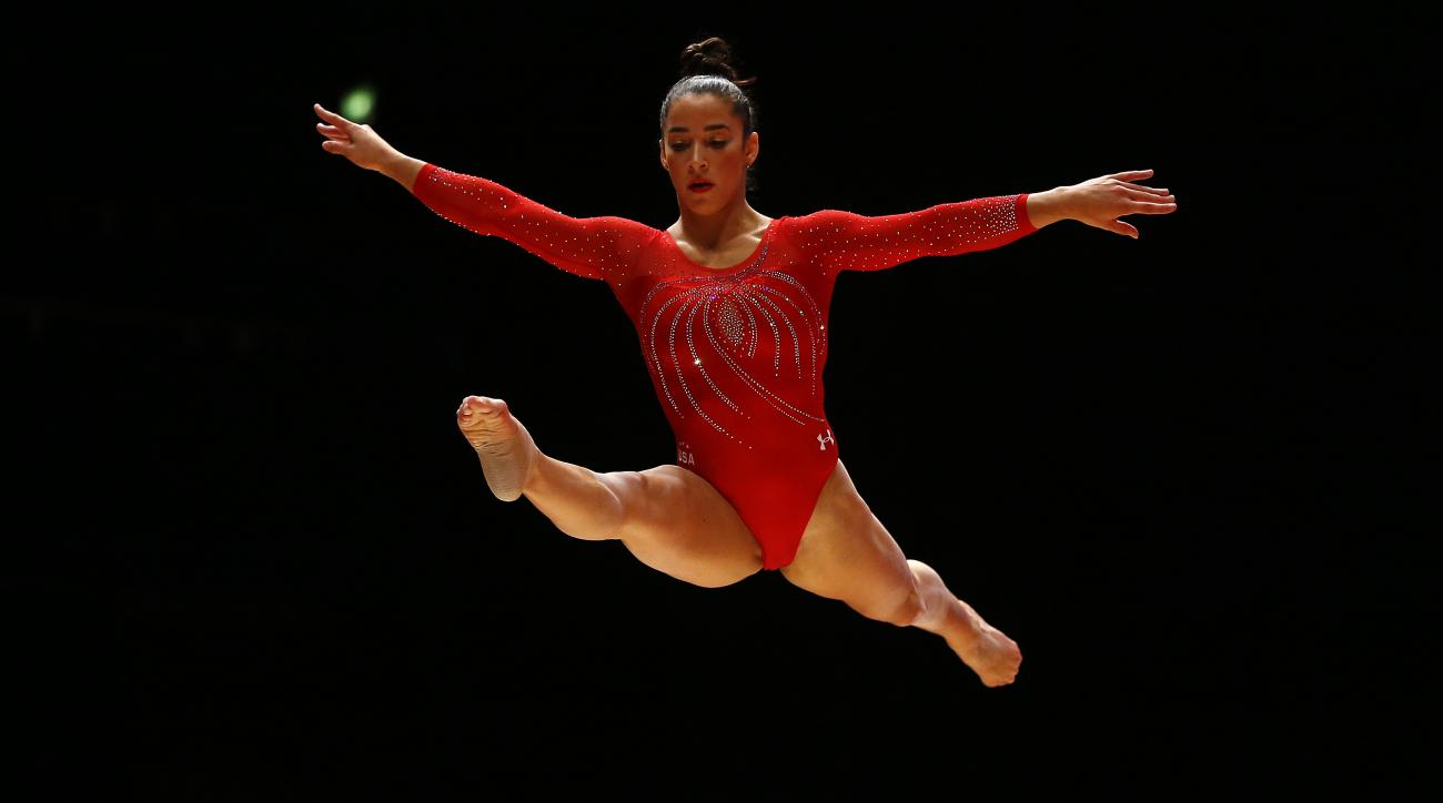 FILE - In this Oct. 27, 2015 file photo, Aly Raisman of the U.S. performs on the balance beam during the World Artistic Gymnastics championships at the SSE Hydro Arena in Glasgow, Scotland. Since Martha Karolyi took over as national team coordinator in 20