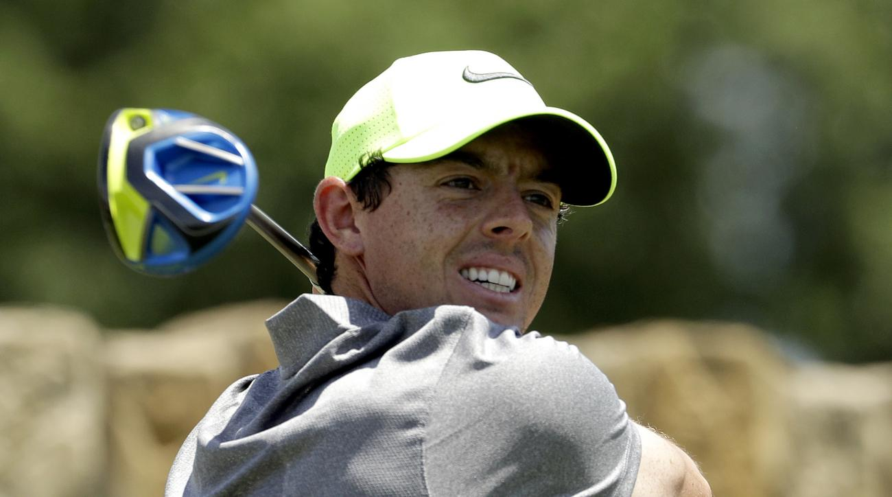 FILE - In this Saturday, June 18, 2016 file photo, Rory McIlroy, of Northern Ireland, watches his tee shot on the ninth hole during the rain delayed second round of the U.S. Open golf championship at Oakmont Country Club, in Oakmont, Pa. McIlroy says he w