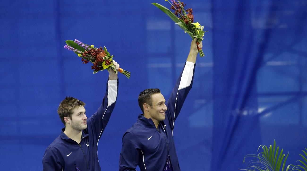 Michael Hixon and Samuel Dorman celebrate after winning the synchronized men's 3-meter springboard final at the U.S. Olympic diving trials Wednesday, June 22, 2016, in Indianapolis. (AP Photo/Darron Cummings)