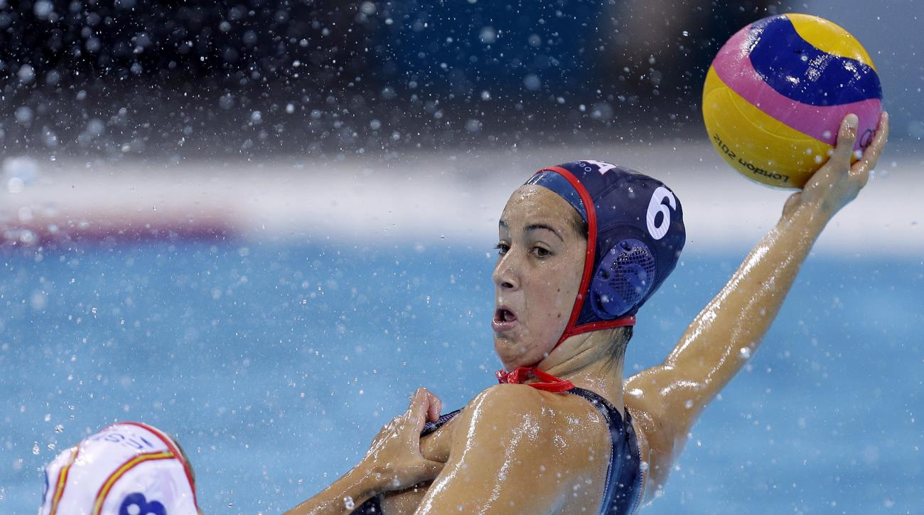 FILE - In this Aug. 1, 2012 file photo, United States' Maggie Steffens, right, is challenged for the ball by Pilar Pena Carrasco of Spain during their women's water polo preliminary round match at the 2012 Summer Olympics in London.   Steffens and the U.S