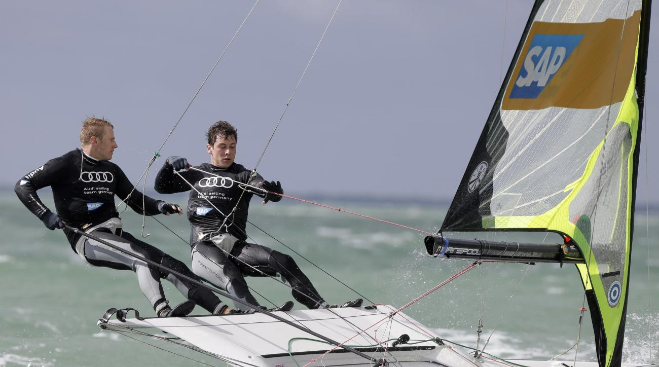 FILE - In this Jan. 26, 2015 file photo, Erik Heil, left, and Thomas PloBel, right, of Germany, compete in the 49er class during the ISAF Sailing World Cup Miami on Biscayne Bay, in Miami. Heil was hospitalized in Berlin and underwent surgery to treat inf