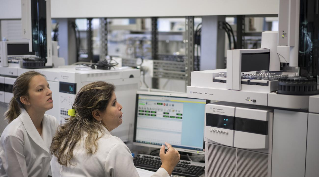 FILE - In this May 8, 2015 file photo, lab technicians work at the Brazilian Doping Control Laboratory, in Rio de Janeiro, Brazil. Just weeks before the Olympic Games open in Rio, the city's accredited anti-doping laboratory has been stopped from conducti
