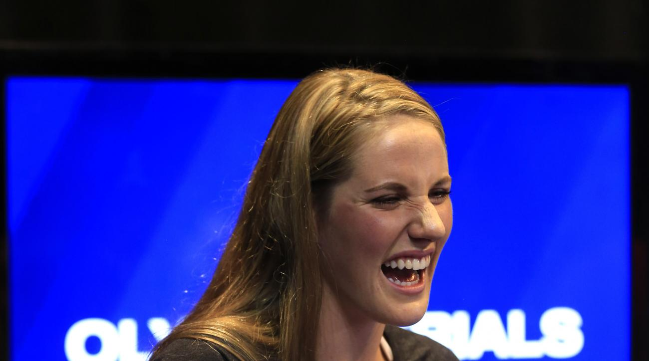 Four-time Olympic gold medalist Missy Franklin talks with friends following a news conference at the U.S. Olympic team swimming trials in Omaha, Neb., Saturday, June 25, 2016. (AP Photo/Orlin Wagner)