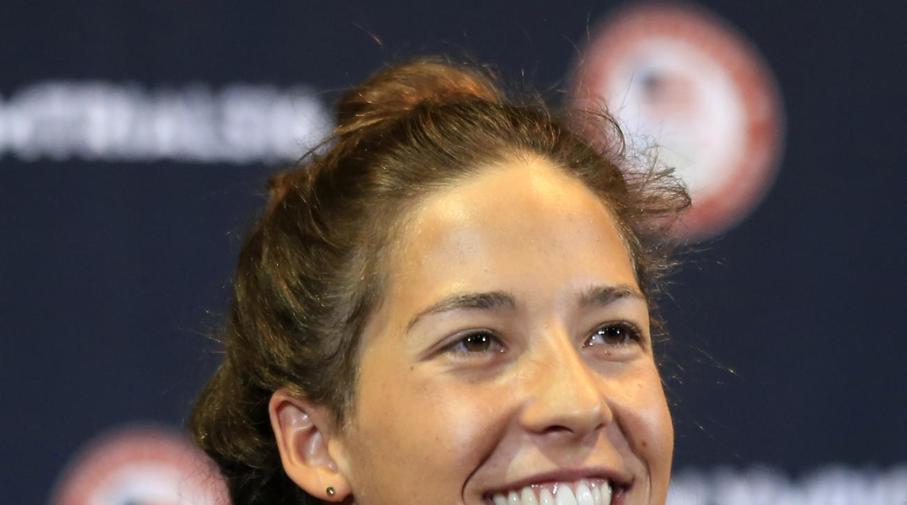 Swimmer Maya DiRado answers a reporters question during a news conference at the U.S. Olympic team swimming trials in Omaha, Neb., Saturday, June 25, 2016. (AP Photo/Orlin Wagner)