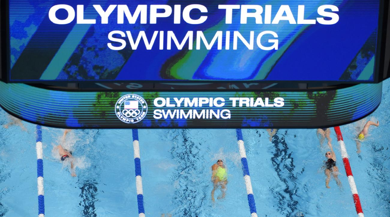 Swimmers train at the U.S. Olympic swimming trials, Saturday, June 25, 2016, in Omaha, Neb. (AP Photo/Mark J. Terrill)