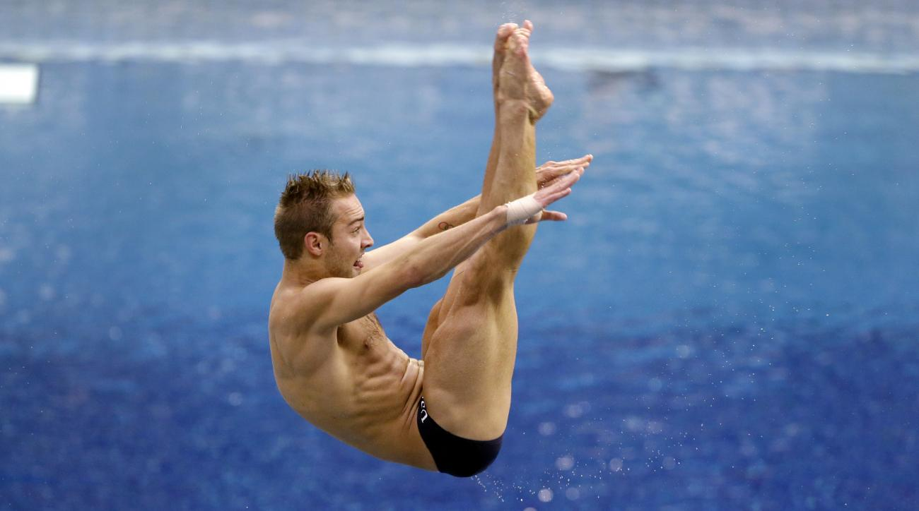Kristian Ipsen performs a dive during the men's three-meter springboard final at the U.S. Olympic diving trials in Indianapolis, Saturday, June 25, 2016. (AP Photo/Michael Conroy)