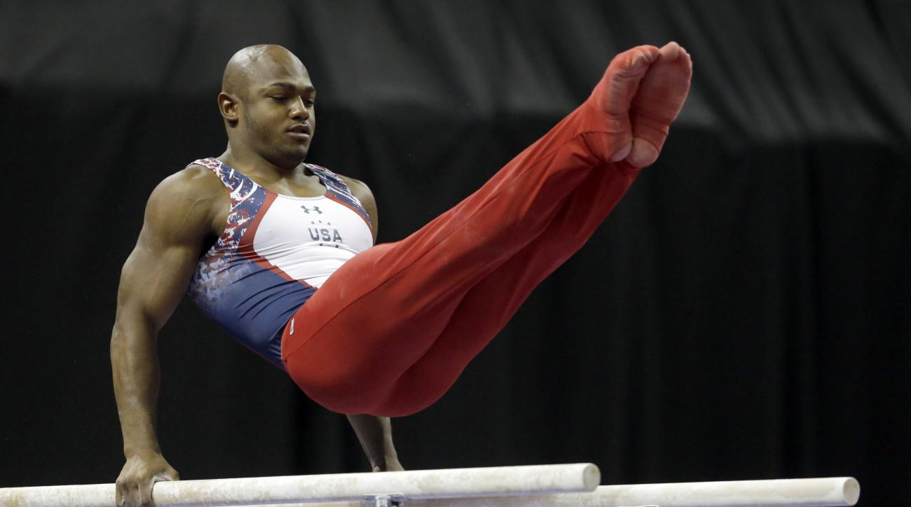 John Orozco competes on the parallel bars during the U.S. men's Olympic gymnastics trials Saturday, June 25, 2016, in St. Louis. Orozco was named to the team following the trials. (AP Photo/Jeff Roberson)