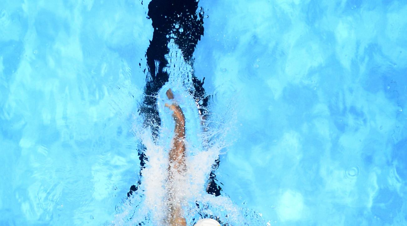Ryan Lochte swims during a preliminary heat in the Men's 400-meter individual medley at the U.S. Olympic swimming trials, Sunday, June 26, 2016, in Omaha, Neb. (AP Photo/Mark J. Terrill)